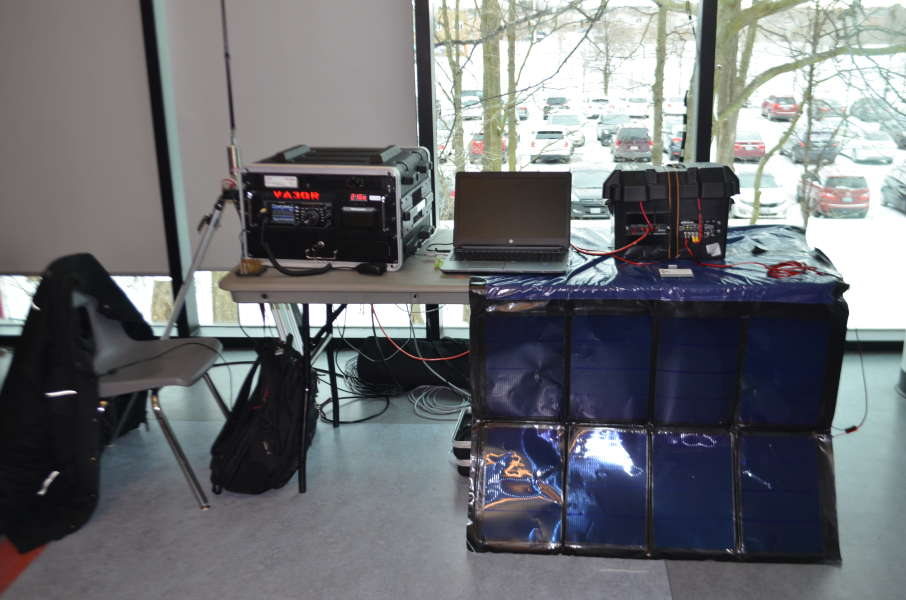 A mobile radio station display set up by a representative from the Canadian Forces Affiliate Radio System